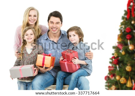 Portrait family with children at home New Year's near  Christmas tree isolated on white background. - stock photo