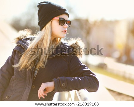 Portrait fashion hipster girl in the city in sunny day, street fashion - stock photo