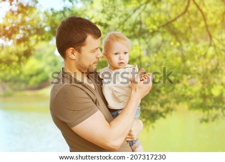 Portrait father and child walks in the park - stock photo
