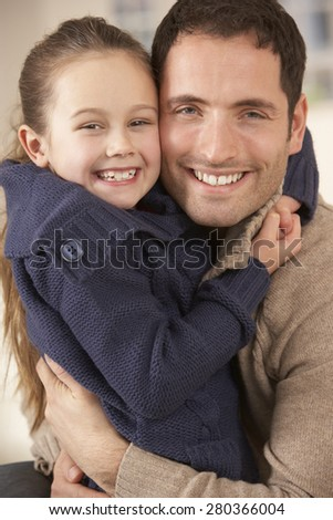 Portrait father and daughter at home - stock photo