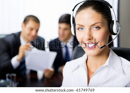 Portrait female support phone operator at workplace - stock photo