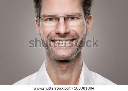 Portrait from a happy and smiling man