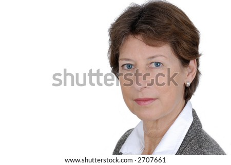 Portrait from a senior business woman. Picture was taken in a studio. - stock photo