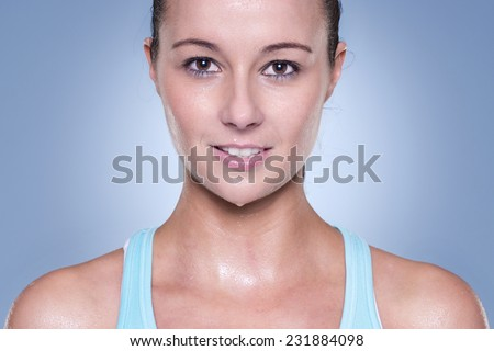 Portrait from a young and sporting woman - stock photo