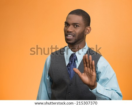 Portrait furious angry annoyed displeased young man raising hands up to say no stop right there isolated orange background. Negative human emotion, facial expression, sign, symbol, body language - stock photo