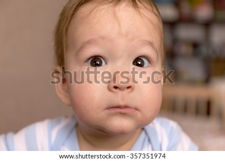 Portrait genuinely surprised baby 7 months of age - stock photo