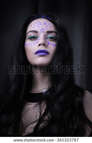 Portrait. Girl with tribal pattern on face. Close up.