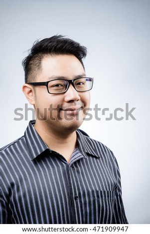 Portrait : gorgeous asian business man with eyeglasses on white background | undercut hairstyle