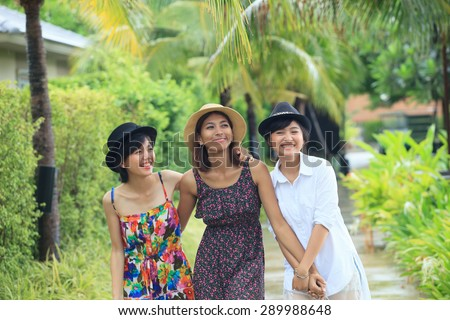 portrait group of asian young woman friend walking in park with relaxing emotion and happiness face - stock photo