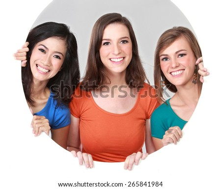 Portrait group of happy teenagers having fun hiding behind the circle