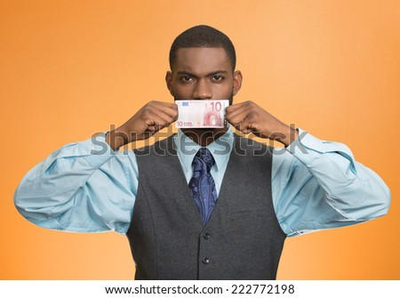 Portrait handsome corrupt guy businessman holding euro bill to mouth silent avoiding truth isolated on orange background. Bribery concept in politics, business diplomacy. Face expression attitude - stock photo