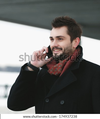 Portrait handsome joyful man talking on the phone - stock photo