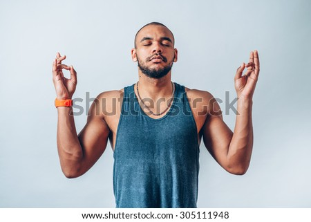 Portrait handsome young man, eyes closed, in meditation zen mode, isolated white background. Stress relief techniques concept take deep breath. Positive human emotions, facial expression sign, feeling - stock photo