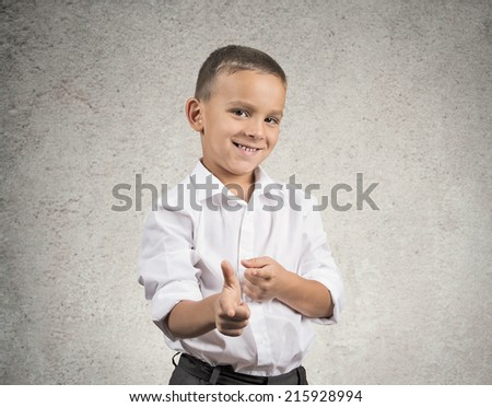 Portrait handsome young smiling man giving thumbs up pointing with fingers at camera, picking you as friend isolated grey wall background. Positive human emotion facial expression sign body language - stock photo