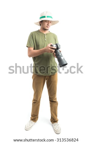 portrait happy asia young man holding camera isolated on a white background