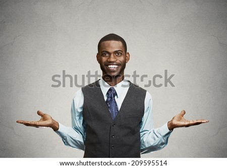 Portrait Happy, Smiling, Friendly business man looking welcoming, arms out isolated grey wall background. Human facial expressions, positive emotions, feelings, body language, life perception  - stock photo