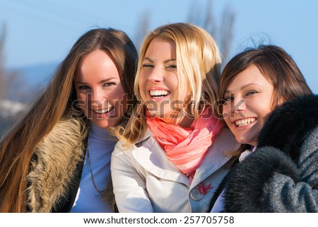 Portrait happy three beautiful young women  - stock photo