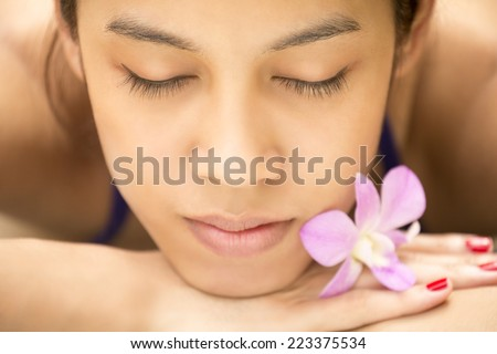 Portrait head shot of asian woman with flower. - stock photo