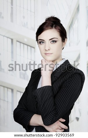 portrait image of a business woman standing - stock photo