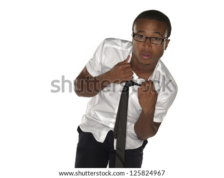 Portrait image of a businessman pulling tie over white background