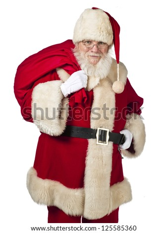 Portrait image of Father Santa carrying gift bag on shoulders.