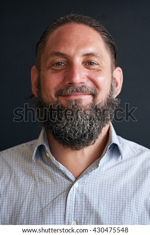 Portrait image of smiling mature man with silvering beard