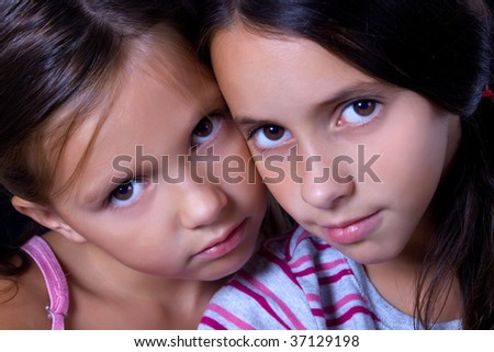 Portrait image of two beautiful young girls
