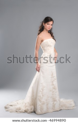 portrait in complete growth of fiancee in a wedding-dress, decorated jewels - stock photo