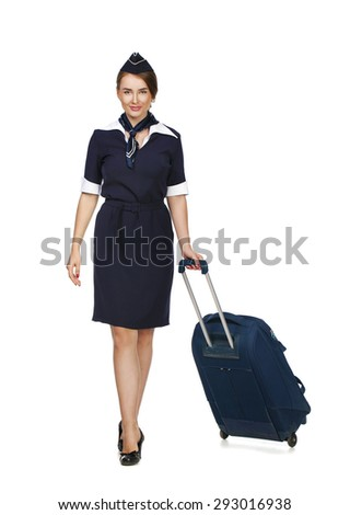 Portrait in full growth stewardess holding suitcase isolated on white background