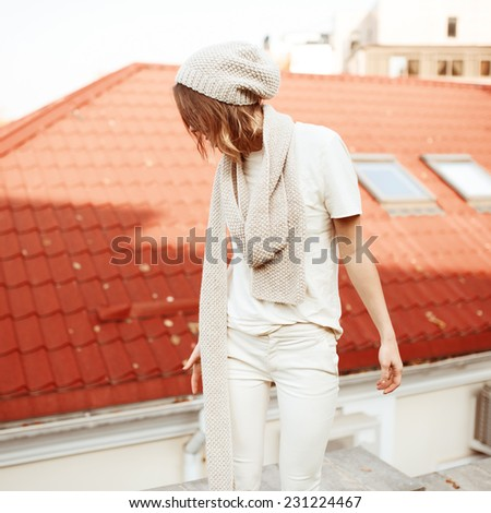 Portrait in profile of beautiful fashionable girl on a sunny day