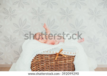 portrait little baby (child) lying in a wooden basket. newborn. son. boy. infant - stock photo