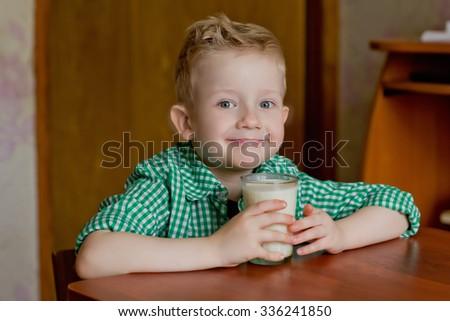 Portrait little boy drinking milk - stock photo