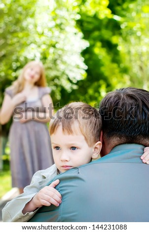 Portrait Little Boy with his family - stock photo