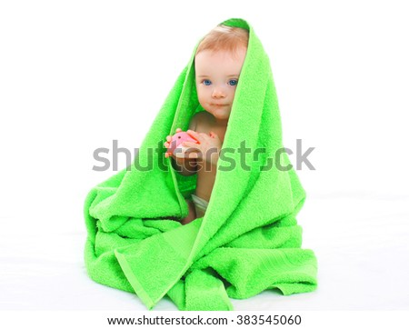Portrait little cute baby under towel on white background - stock photo