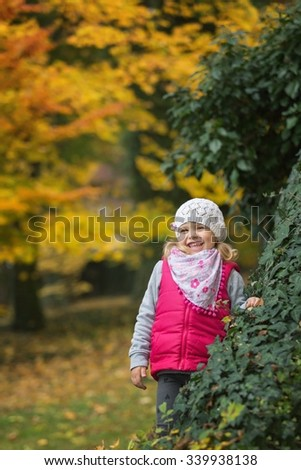 Portrait little girl in autumn park - stock photo