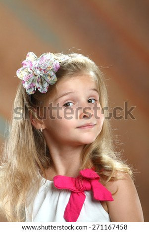 portrait little girl with long blond hair .  interesting emotions - stock photo