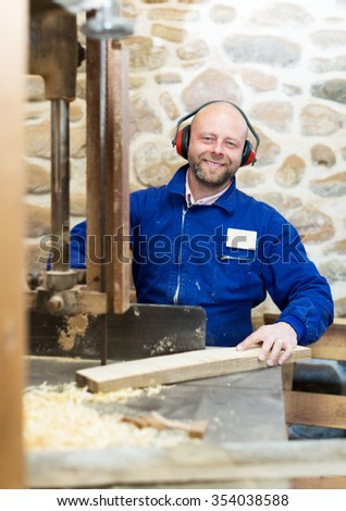portrait male worker on lathe at  wood workroom