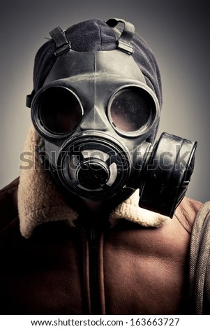 Portrait man in gas mask.