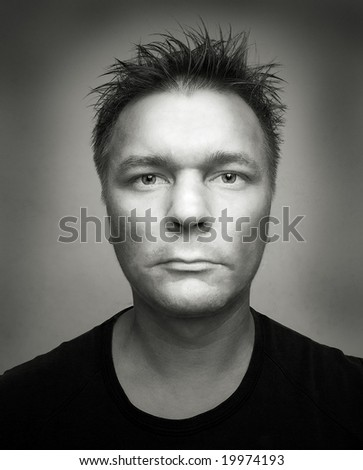 portrait man shoot on wide angle lens on gray background