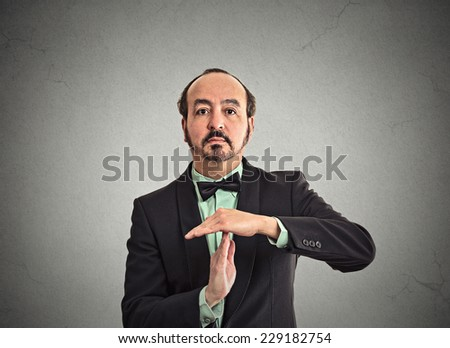 Portrait middle aged businessman executive showing time out sign hand gesture. Human emotion, body language, reaction, sign, symbol. Negotiation, meeting, politics concept - stock photo