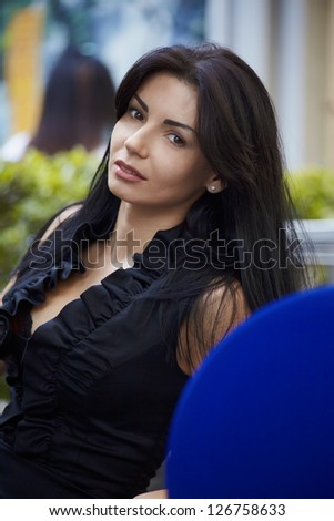 Portrait modern brunet woman in outdoor street cafe