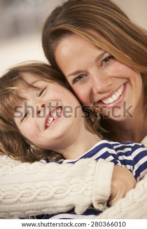 Portrait mother and son at home - stock photo