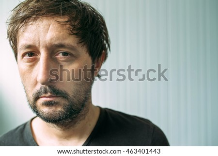 Portrait od miserable and tired adult man, depressive male with serious face expression