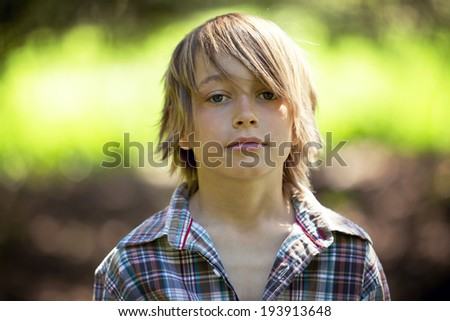 Portrait Of A Adorable Young Boy - stock photo