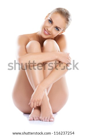 Portrait of a adorable young woman with a gorgeous figure, sitting isolated