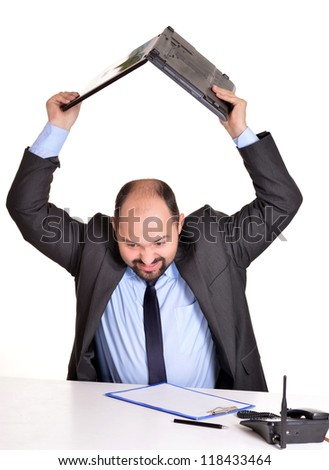 portrait of a adult man and computer on white - stock photo