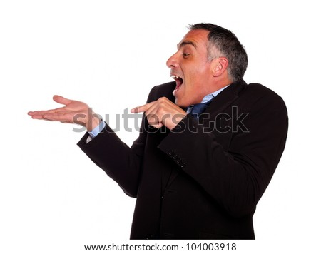 Portrait of a adult man looking and pointing extended right hand against white background - stock photo
