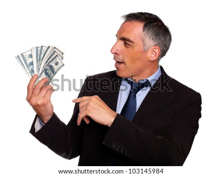 Portrait of a ambitious executive looking plenty of dollars on isolated background - stock photo
