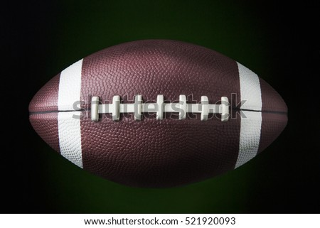 portrait american football ball dark background stock photo royalty