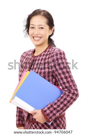 Portrait of a asian business woman holding a file document - stock photo